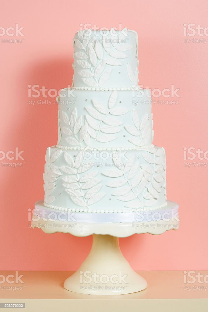 Three-Tiered White Wedding Cake stock photo