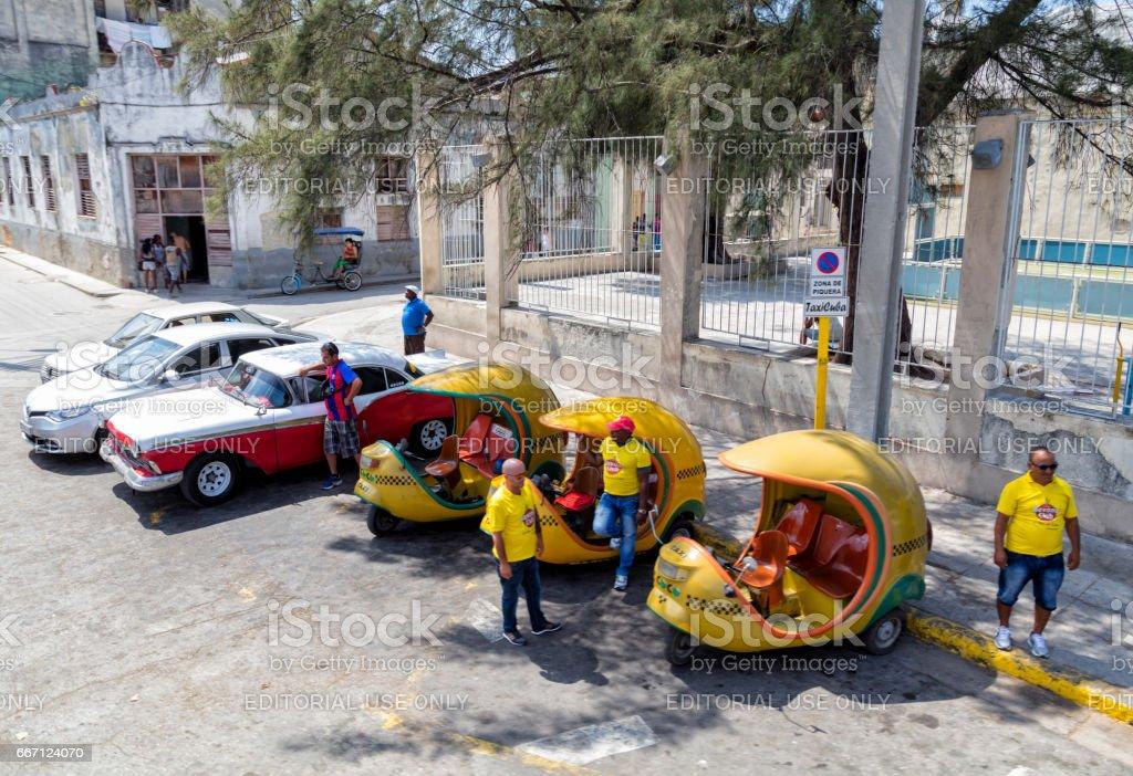 Three-wheeled Coco Taxis in Havana Vieja, Cuba stock photo