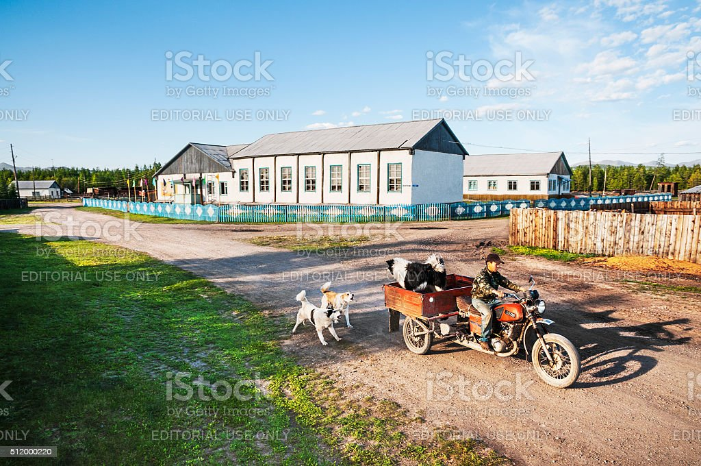 Three-wheeled motorcycle with a body on  street in the village stock photo