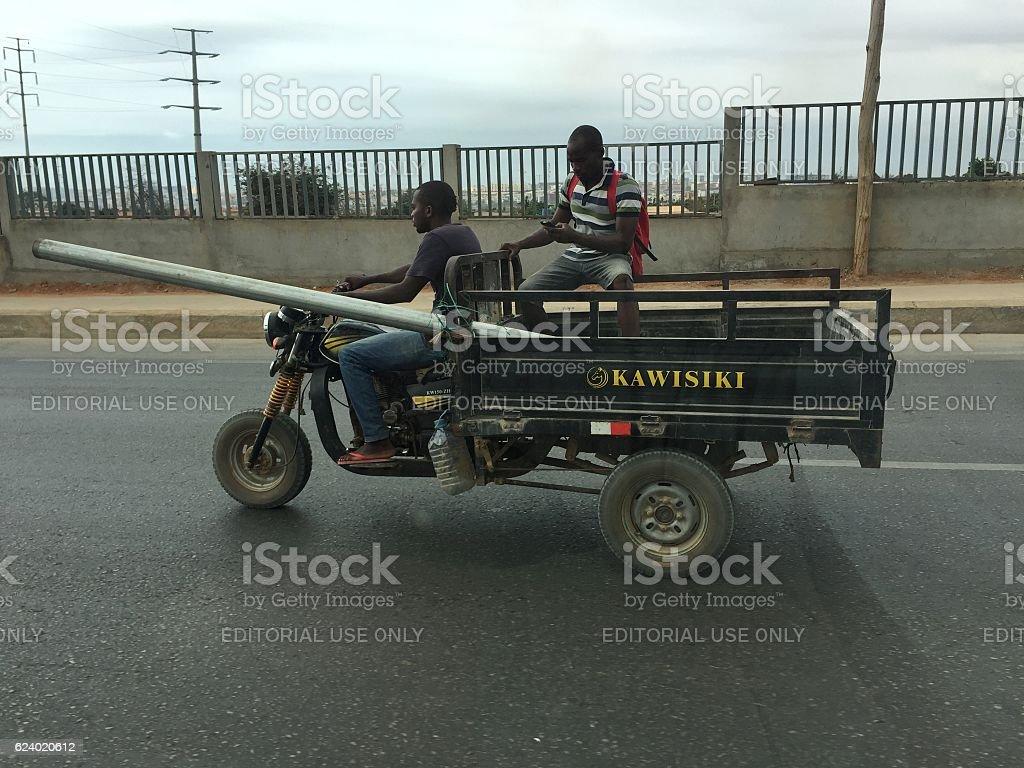 Three-wheeler Chinese bike in Luanda, Angola stock photo