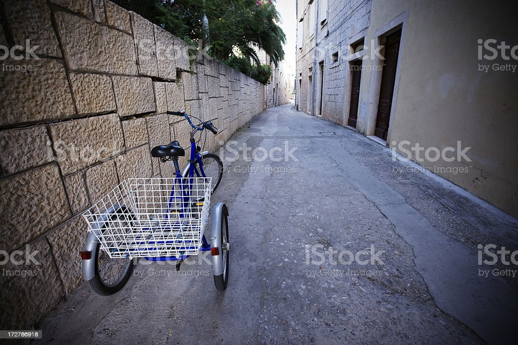 Three-wheeler in old street royalty-free stock photo