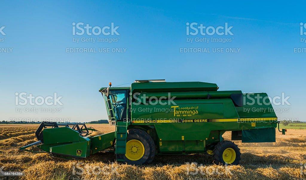 Threshing Machine on a Grain Field stock photo