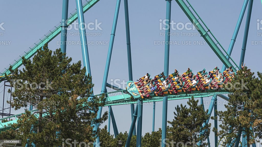 Thrill and emotions of a ride in an amusement park royalty-free stock photo