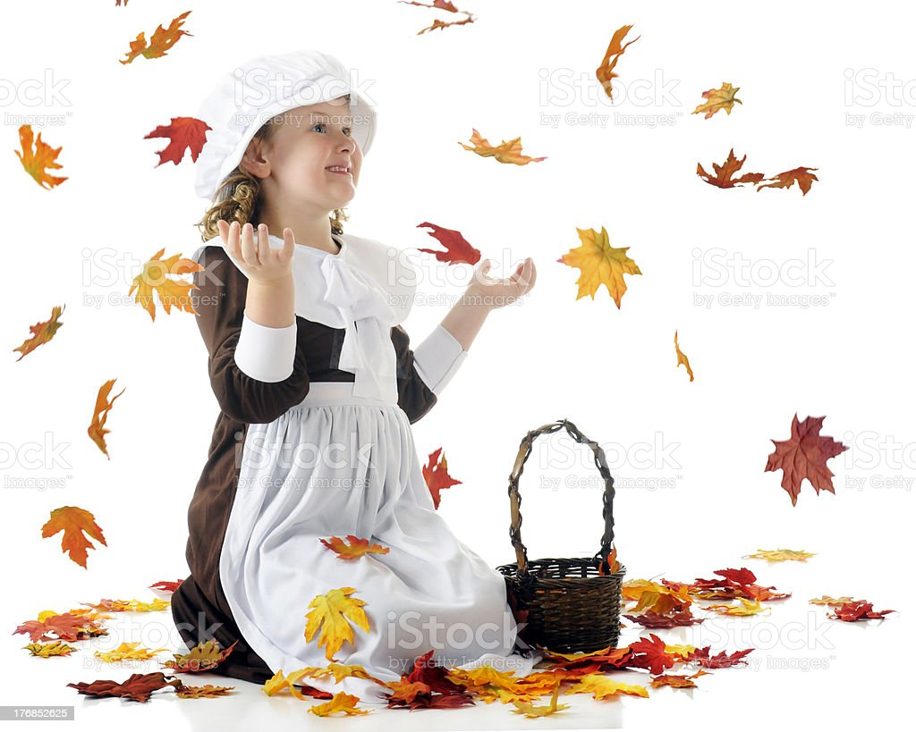 Thrilled with Falling Leaves stock photo