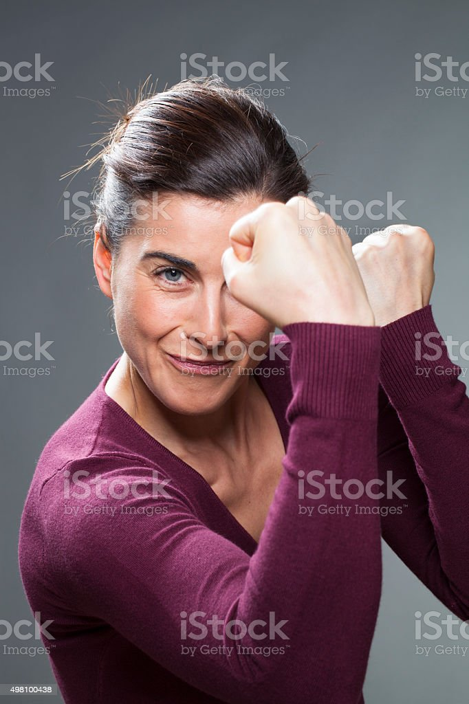 thrilled young woman countering a fight with her body language stock photo