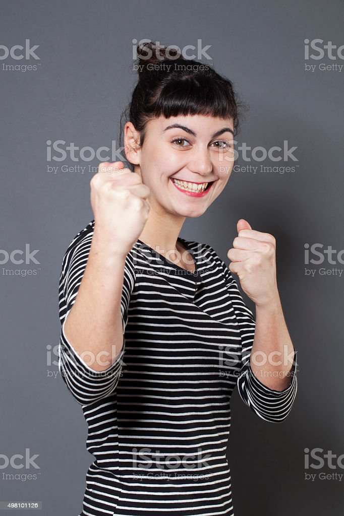 thrilled young woman with fair skin with playing self-defense stock photo