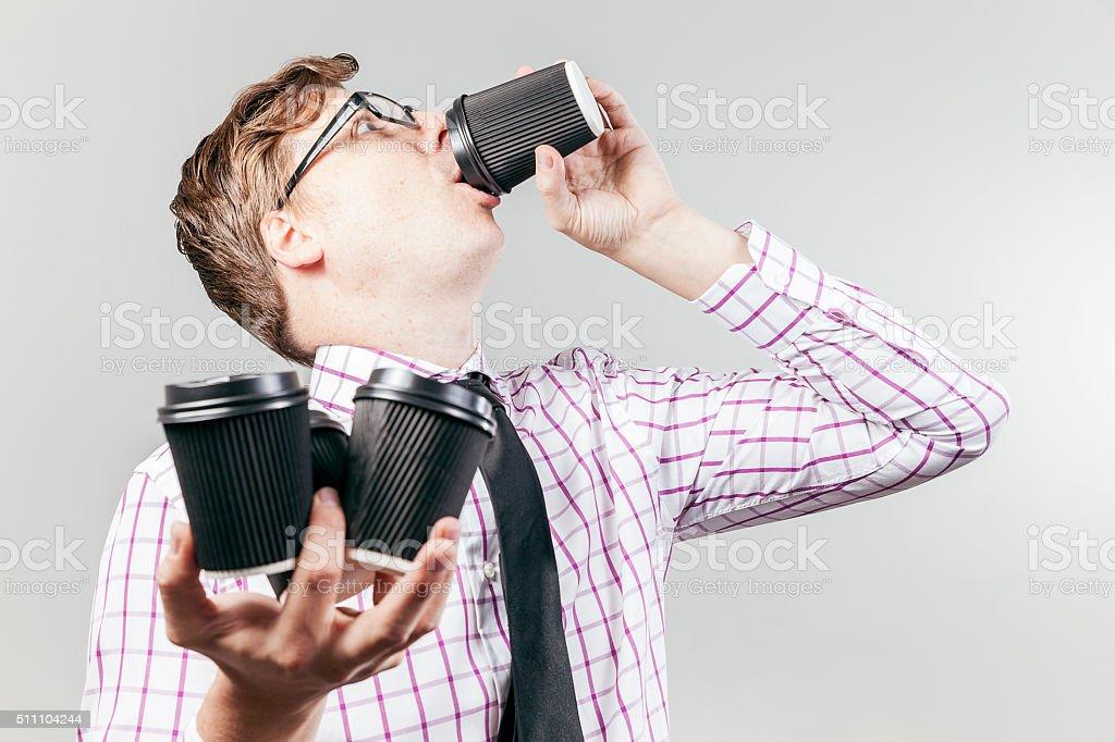 Thristy business nerd drinking coffee stock photo