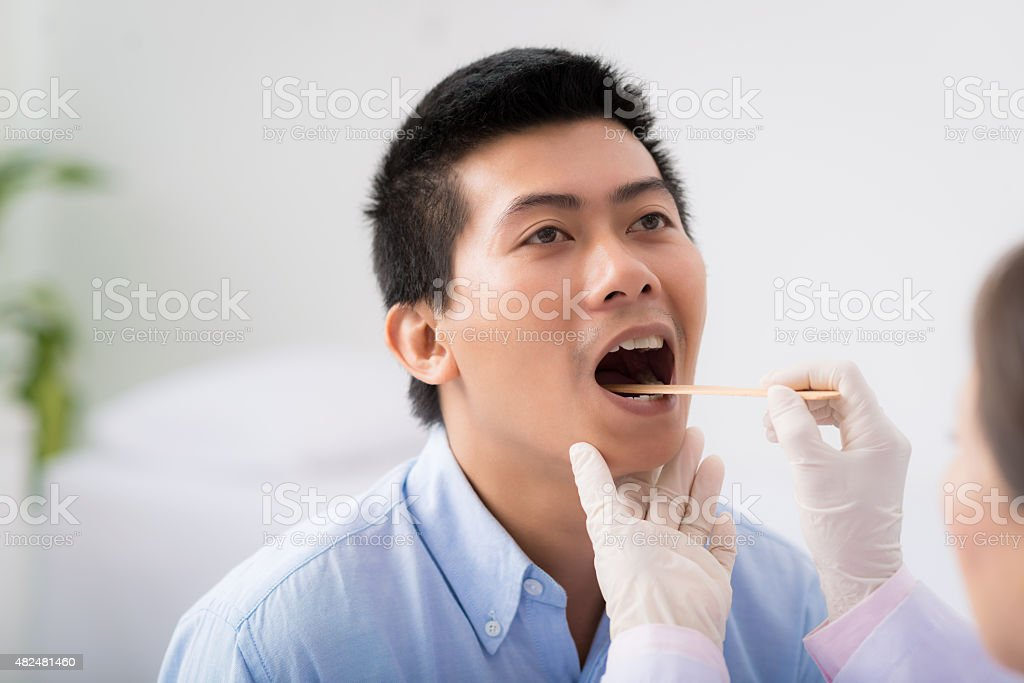 Throat examination stock photo