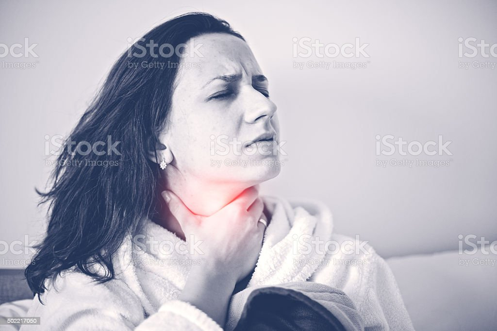 Throat pain stock photo