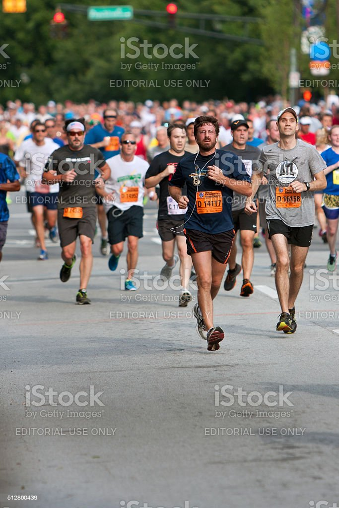 Throng Of Runners Run In July 4 Atlanta Road Race stock photo