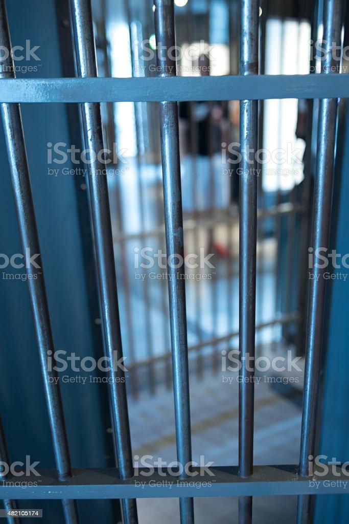 Through prison bars stock photo