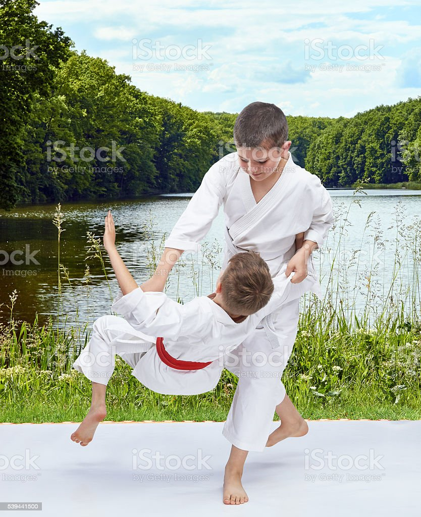 Throw judo athletes are doing on the background of nature stock photo