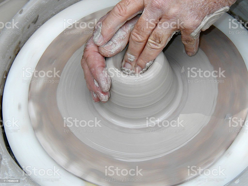 throwing a bowl on potters wheel 1 of 5 royalty-free stock photo