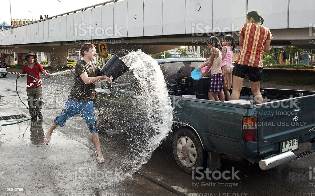 Throwing a Bucket Full stock photo