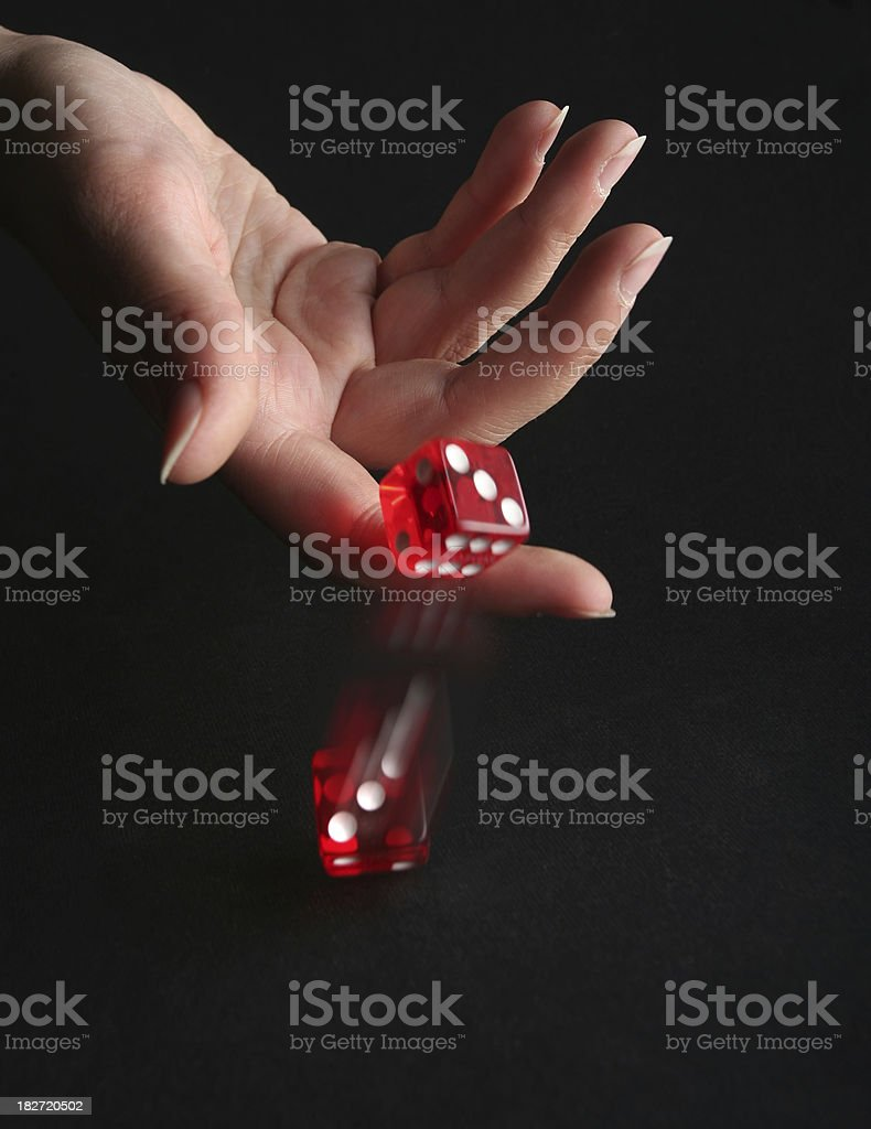 throwing a dice stock photo