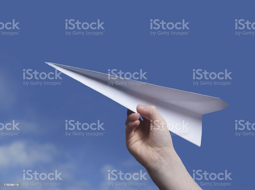 throwing a paper plane.. stock photo