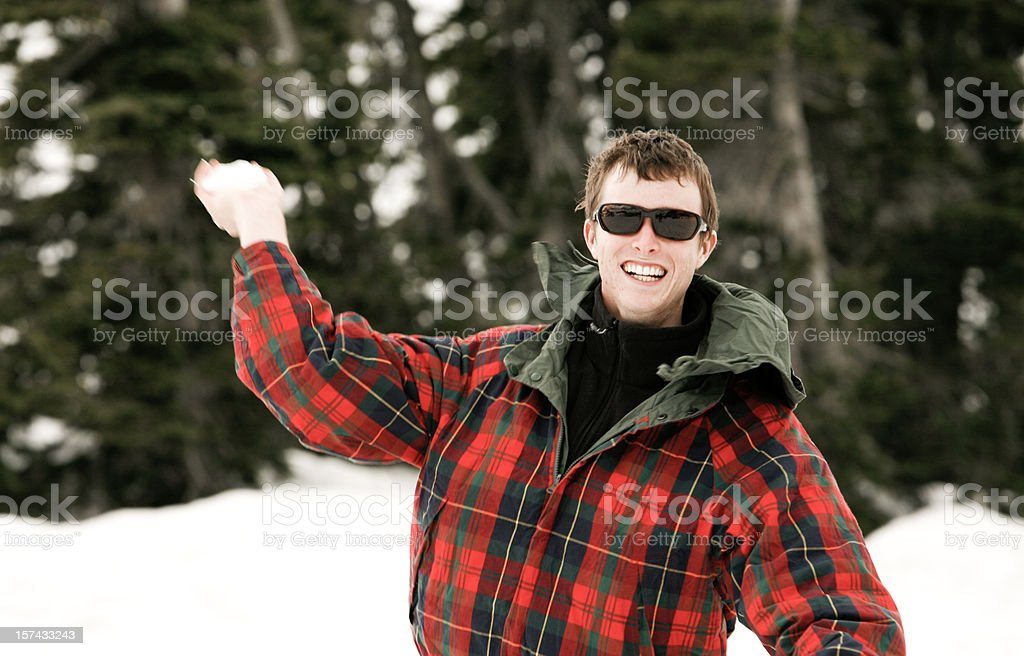 Throwing a snowball royalty-free stock photo