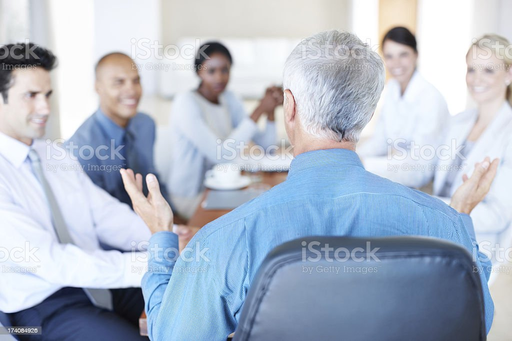 Throwing around ideas in the boardroom royalty-free stock photo
