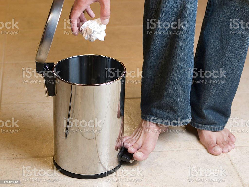 Throwing garbage away stock photo