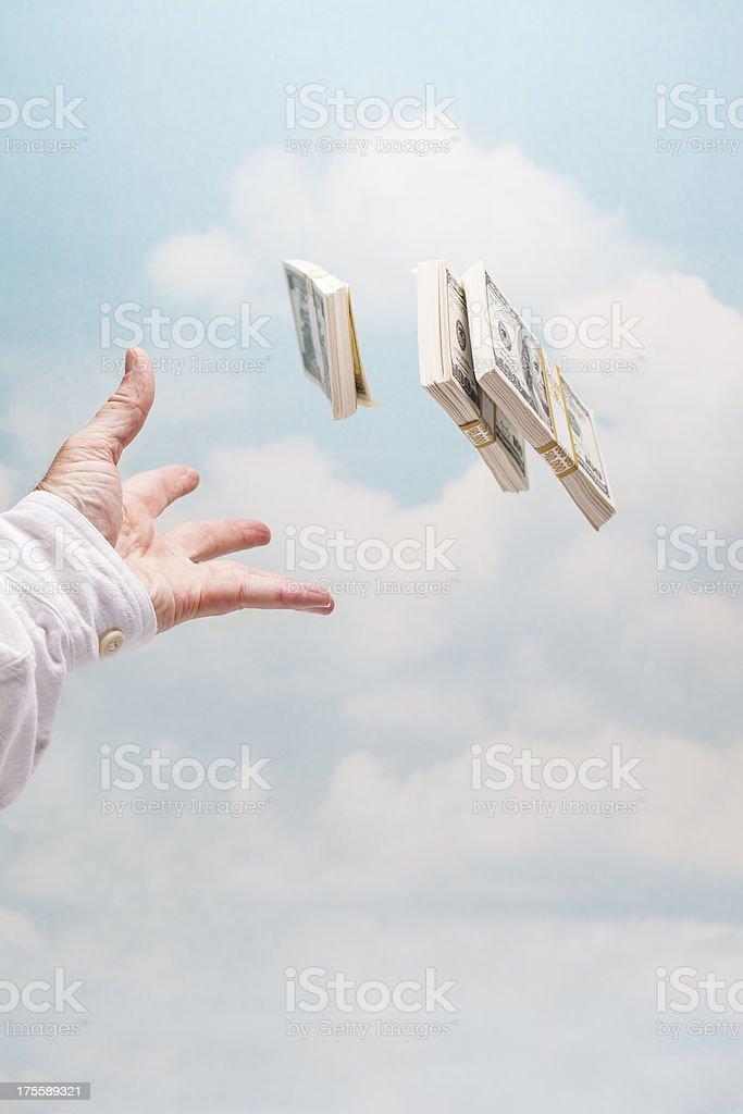 Throwing money away stock photo