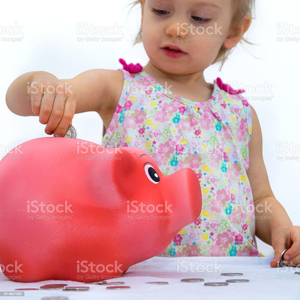 throwing money into piggy bank stock photo