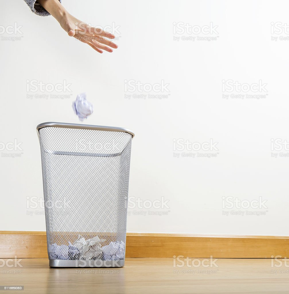 Throwing of paper ball stock photo