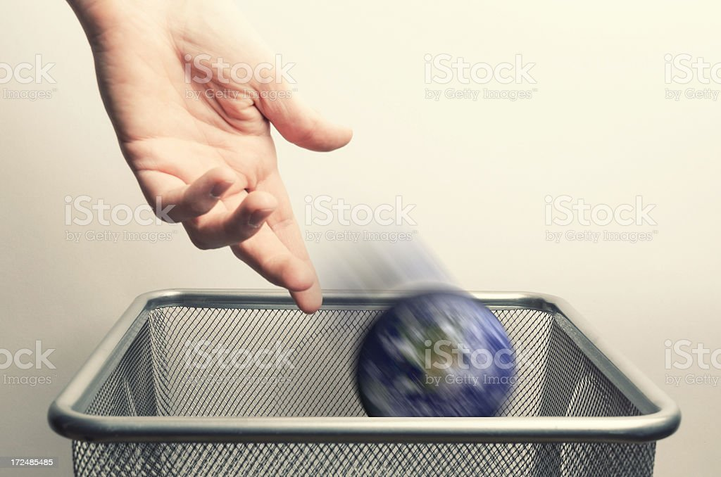 Throwing the earth into a dustbin royalty-free stock photo