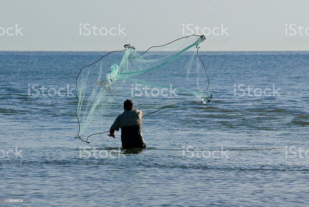Throwing the net royalty-free stock photo