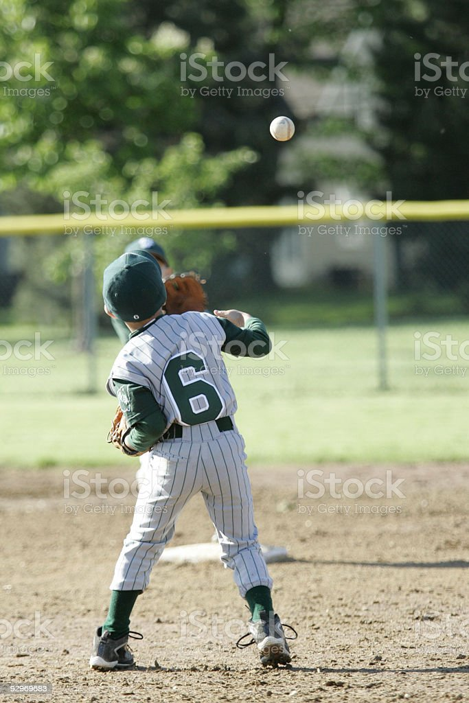 Throwing to second royalty-free stock photo