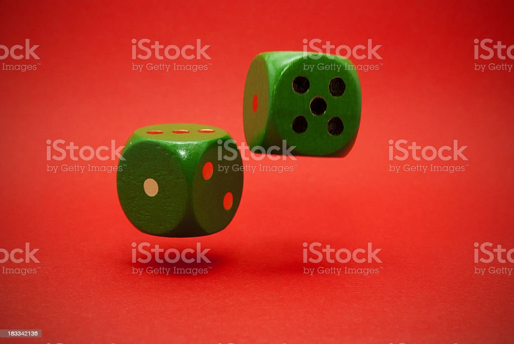 Thrown green dice in the air royalty-free stock photo
