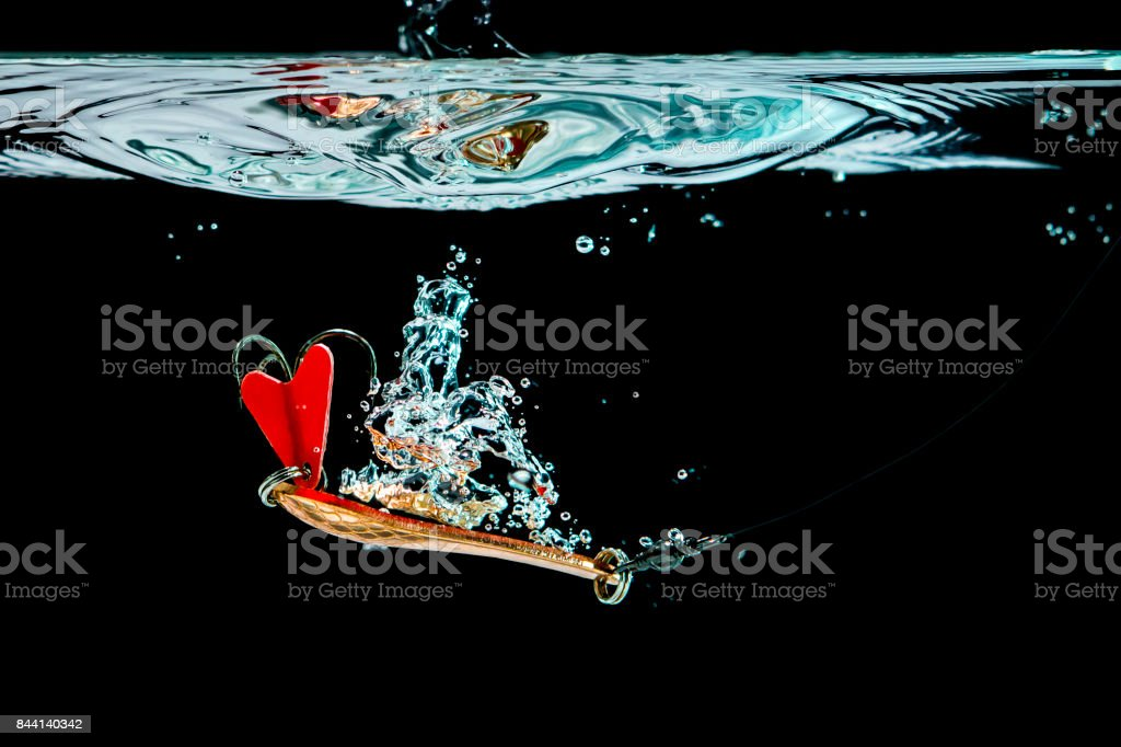 Thrown in the water spinning the spinner stock photo