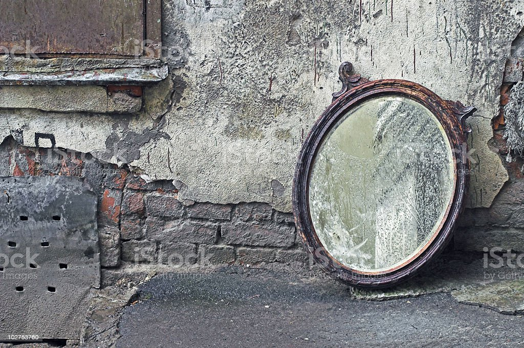 Thrown Out Old Mirror stock photo