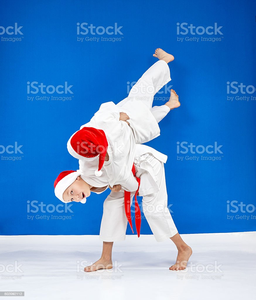 Throws Judo the athletes are train in caps Santa Claus stock photo