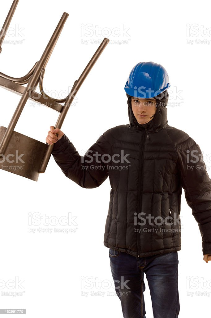 Thug making a threatening gesture with chair stock photo