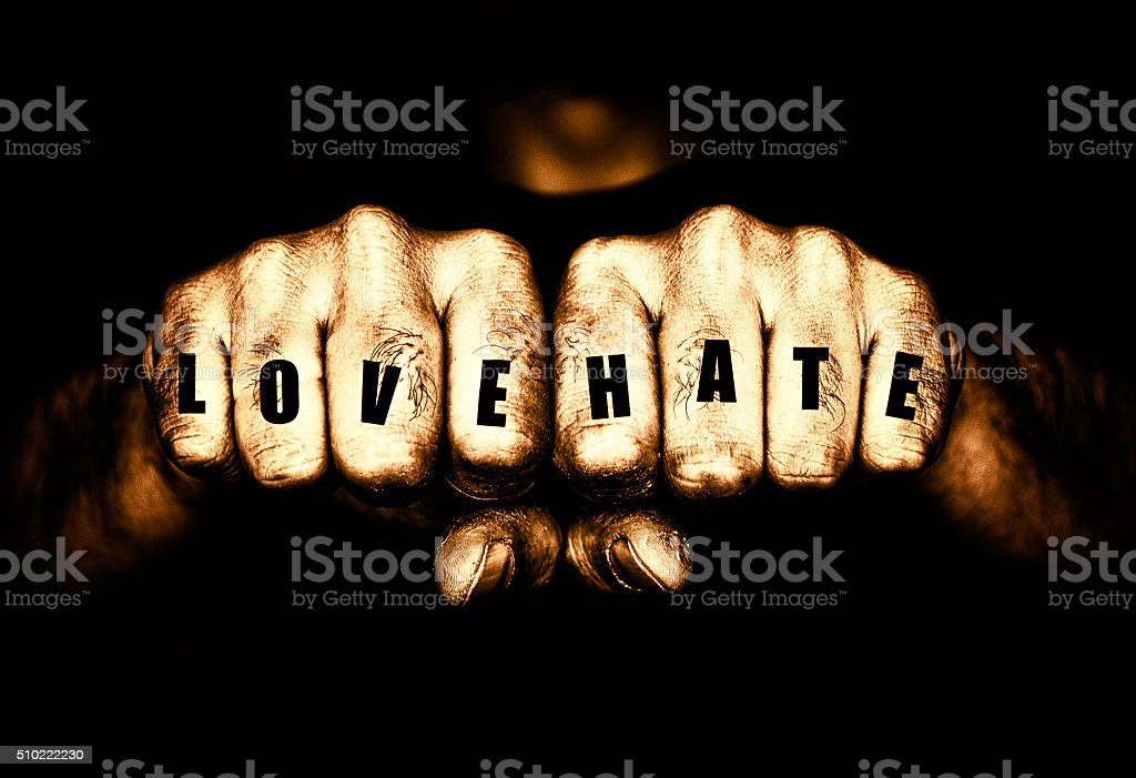 Thugs Love and Hate Tattoo Fists stock photo