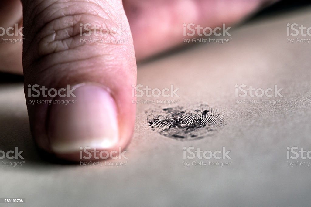 Thumb and fingerprint stock photo