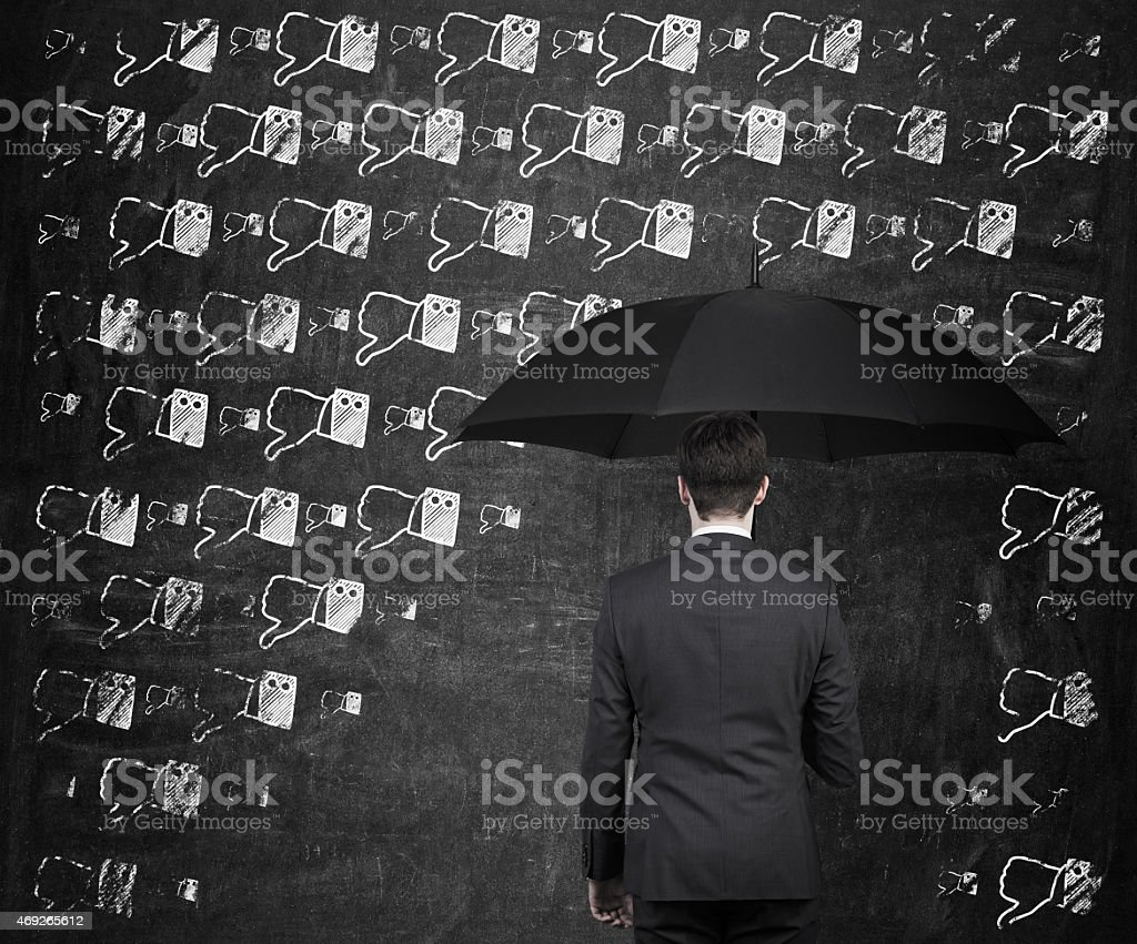 thumb down rain stock photo
