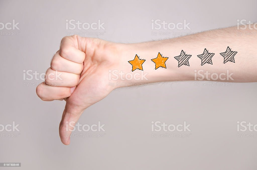 Thumb down with two star rating stock photo