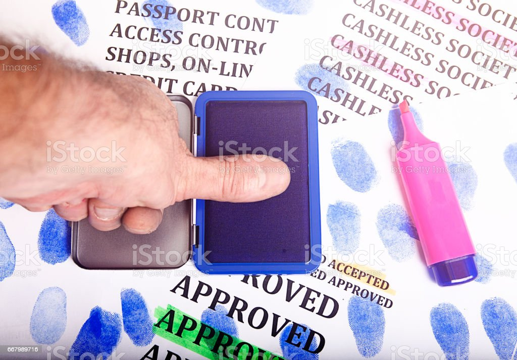 Thumb stamp for cashless society stock photo