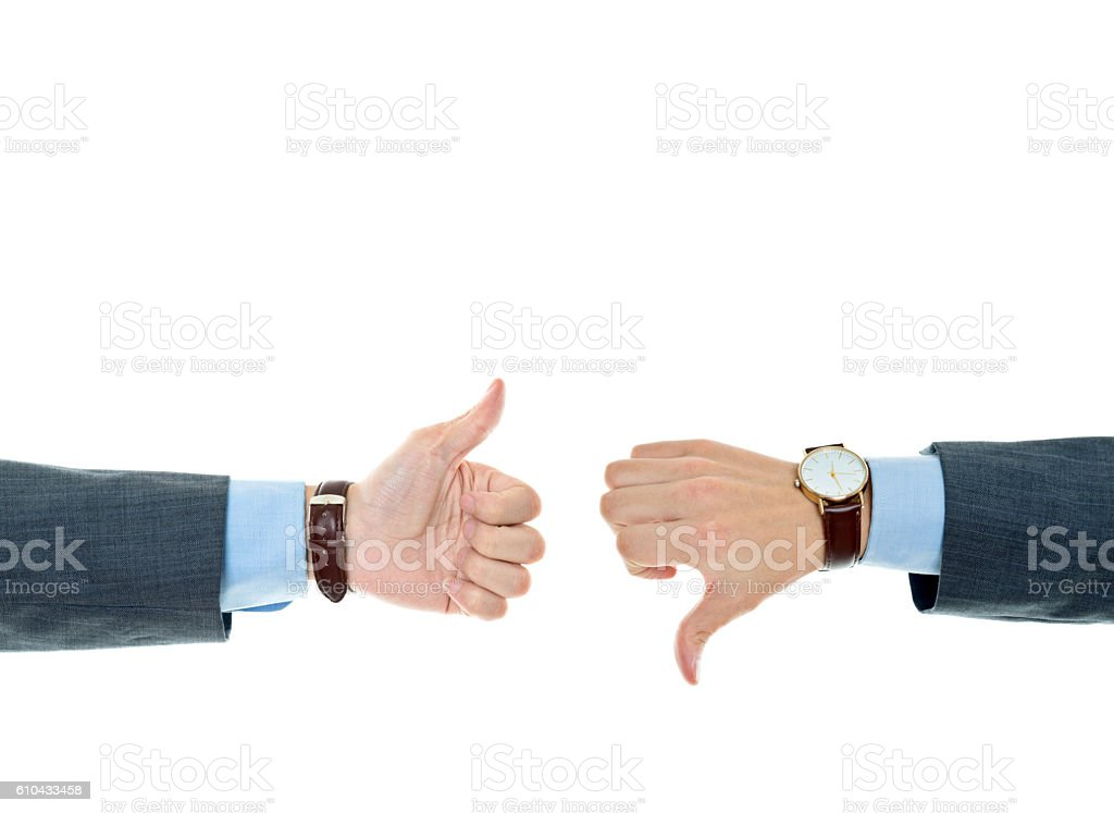 Thumb up and down hand signs against white background stock photo