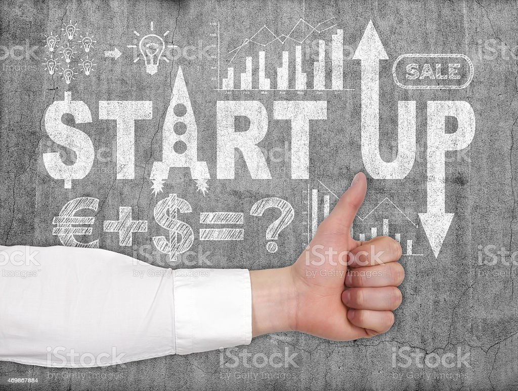 thumb up and start up stock photo
