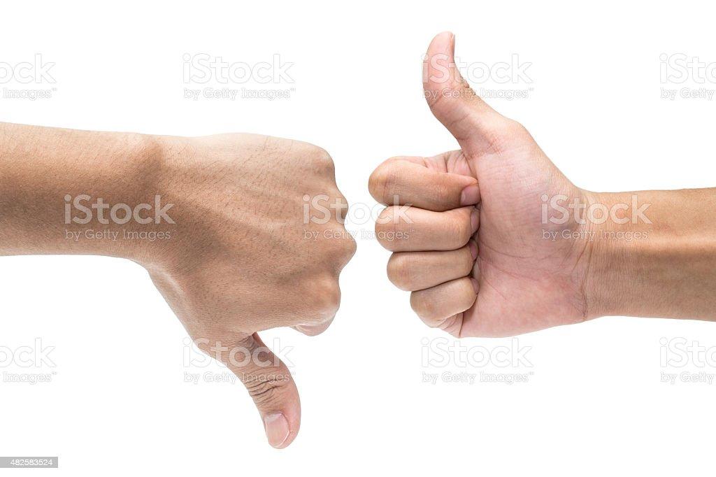 Thumb up and thumb down hand stock photo