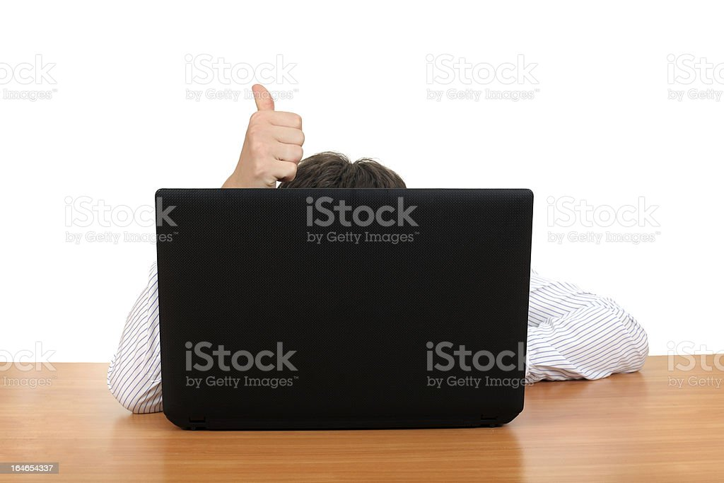 Thumb Up Behind Laptop royalty-free stock photo