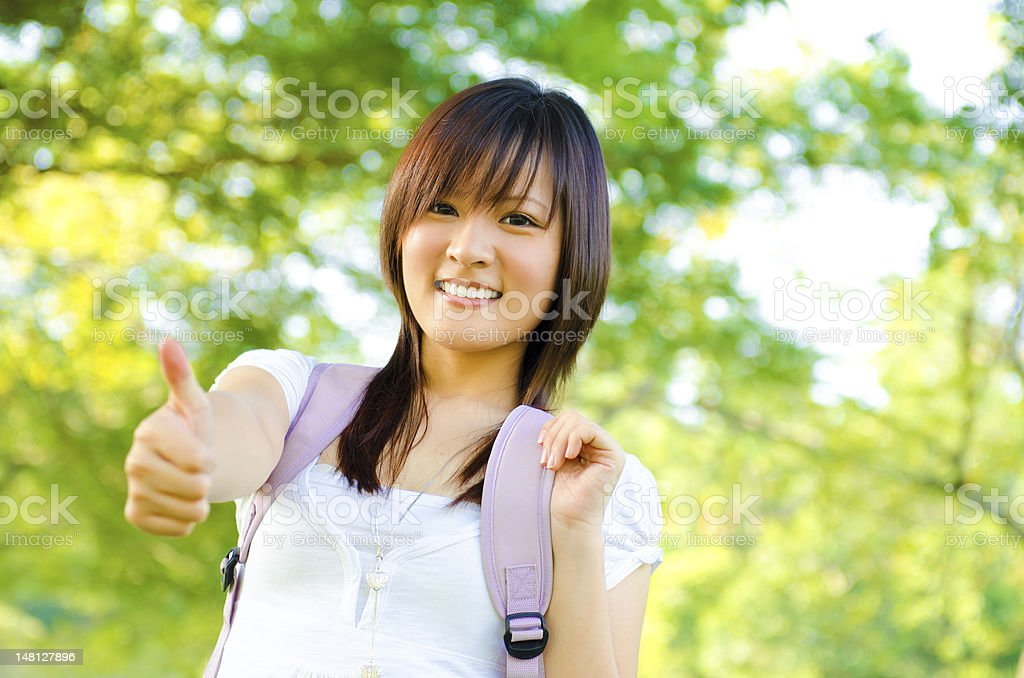 Thumb up college girl royalty-free stock photo