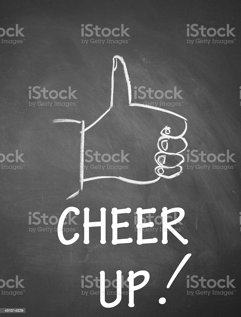 thumb up gesture drawn with chalk on blackboard stock photo