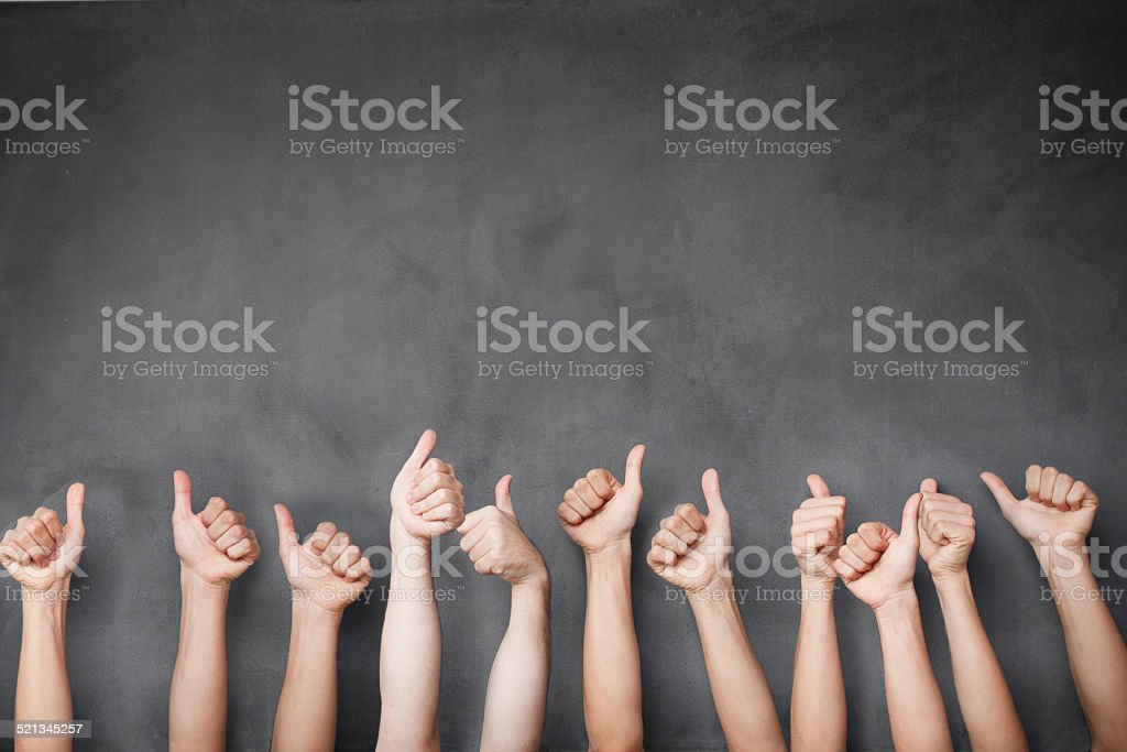 Thumb up hands of a group stock photo