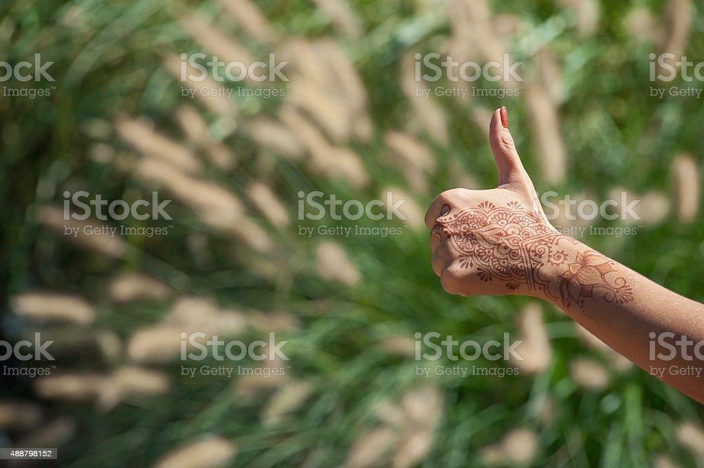 thumb up henna stock photo