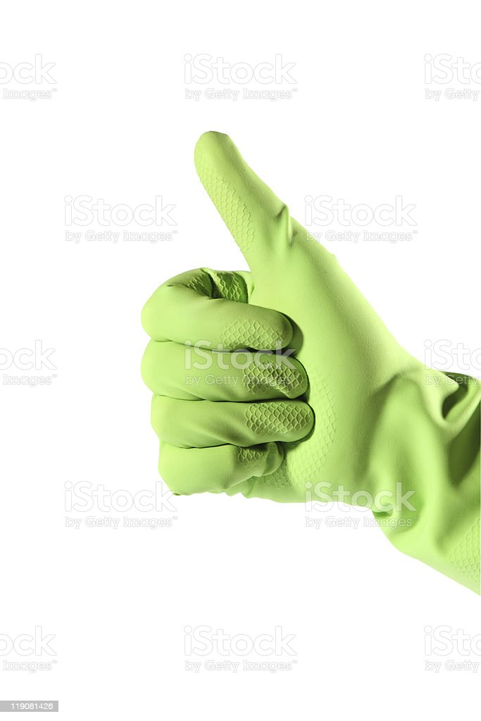 Thumb up in green rubber glove stock photo