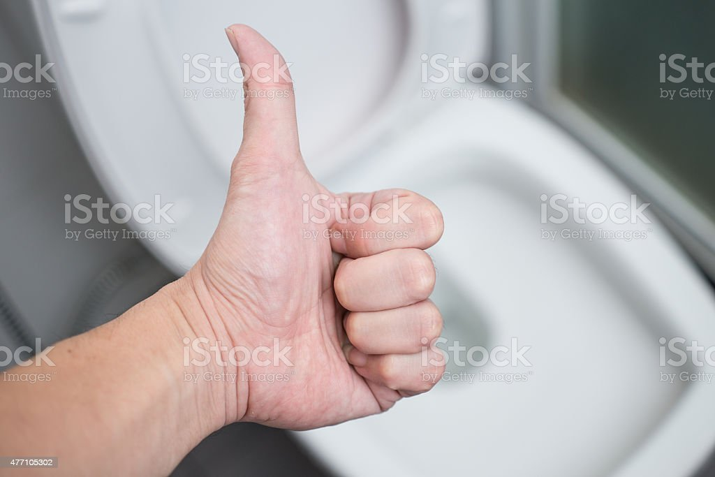 Thumb Up with background cleaning Toilets Bathroom. stock photo