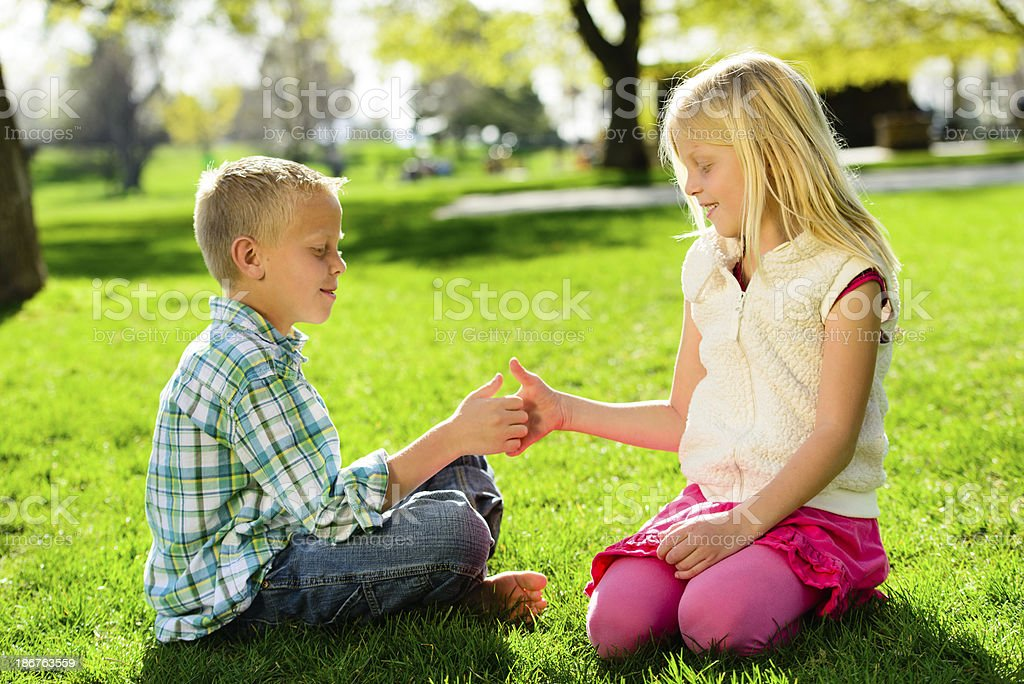 Thumb War in the Park stock photo